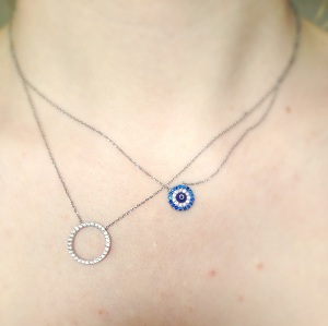 Evil eye necklace and silver ring necklace by Wishlist London.